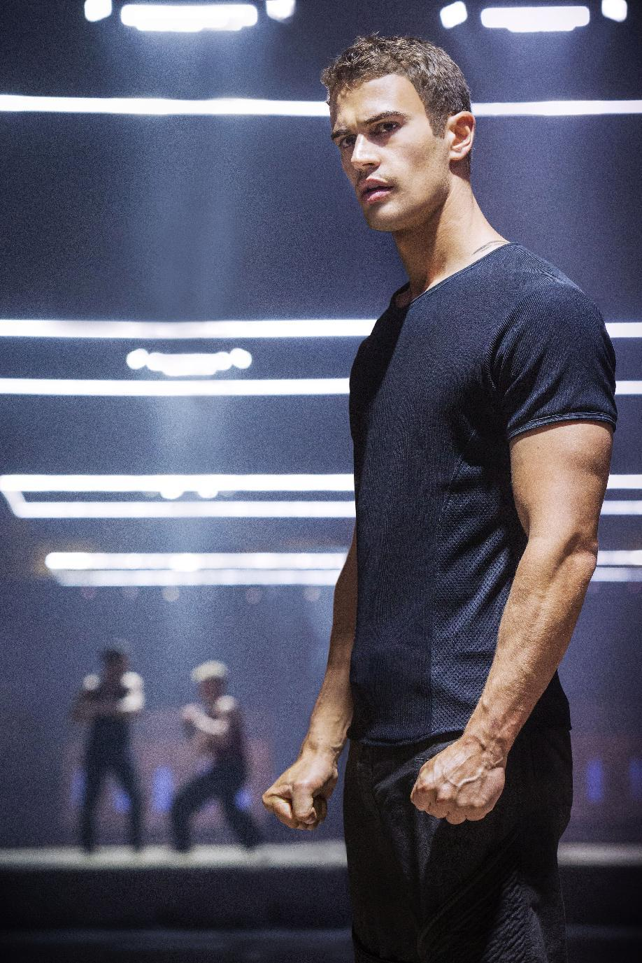 "This publicity photo released by Summit Entertainment shows Theo James in a scene from the film, ""Divergent."" (AP Photo/Summit Entertainment, Jaap Buitendijk)"