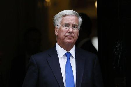 Britain's Secretary of State for Defence Michael Fallon leaves after attending a cabinet meeting at Number 10 Downing Street in London