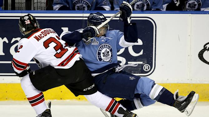 Quebec Remparts' Ross MacDougall (32) collides with Rimouski Oceanics' Michael Joly during the first period of their Memorial Cup hockey game at the Colisee Pepsi in Quebec City
