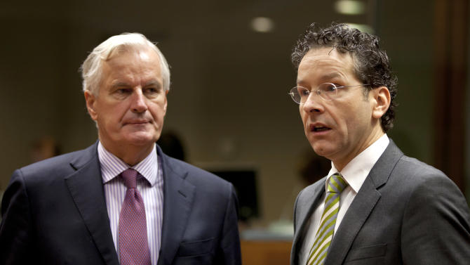 European Commissioner for Internal Market Michel Barnier, left, speaks with Dutch Finance Minister and newly appointed chief of the eurogroup Jeroen Dijsselbloem during a meeting of EU finance ministers at the EU Council building in Brussels on Tuesday, Jan. 22, 2013. Eleven eurozone countries seeking to unilaterally implement a financial transaction tax are expected Tuesday to receive the blessing of other European Union countries, bringing the once-controversial project one step closer to reality.  At center is Thomas Weber, and member of the EU delegation. (AP Photo/Virginia Mayo)
