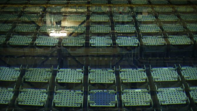 A view shows the pool storage where spent nuclear fuel tanks are unload in baskets under 4 meters of water to decrease temperature as part of the treatment of nuclear waste at the Areva Nuclear Plant of La Hague, near Cherbourg