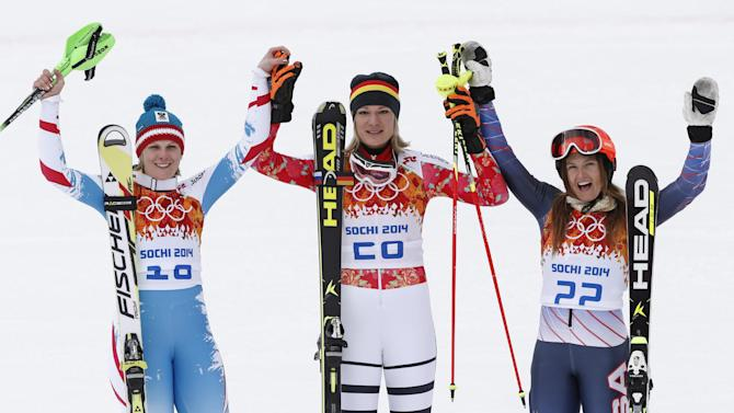 Hoefl-Riesch wins super-combined; 3rd Olympic gold