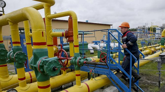 "A worker checks equipment at an ""Dashava"" underground gas storage facility near Striy"