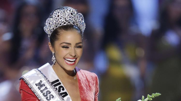 Miss USA, Olivia Culpo, waves to the crowd after being crowned Miss Universe during the Miss Universe competition, Wednesday, Dec. 19, 2012, in Las Vegas. (AP Photo/Julie Jacobson)