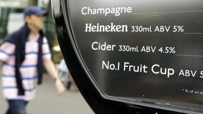 """Pimms, a popular English liqueur, is listed as """"No. 1 Fruit Cup"""" on a drink menu at the All England Lawn Tennis Club at Wimbledon, in London, at the 2012 Summer Olympics, Wednesday, Aug. 1, 2012. Olympic branding regulations have restricted many familiar brand names from being shown in connection with the games. (AP Photo/Mark Humphrey)"""
