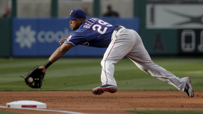 Texas Rangers third baseman Adrian Beltre catches a liner by Los Angeles Angels' Albert Pujols during the first inning of a baseball game in Anaheim, Calif., Saturday, April 25, 2015. (AP Photo/Chris Carlson)