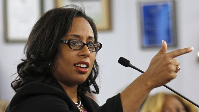 FILE - In this Dec. 15, 2012 file photo, Illinois state Sen. Toi Hutchinson speaks during a candidate presentation at the 2nd Congressional District slating meeting in South Holland, Ill.  Hutchinson is one of more than a dozen candidates running in a special primary election Feb. 26 to replace former Congressman Jesse Jackson Jr. who resigned in November 2012. Like much of the national conversation these days, the race to replace Jackson in Congress has been dominated by one topic: guns.  Nearly half of 2nd District voters live on the South Side of Chicago, where some of the nation's worst gun violence has been heavily concentrated. (AP Photo/John Smierciak, File)