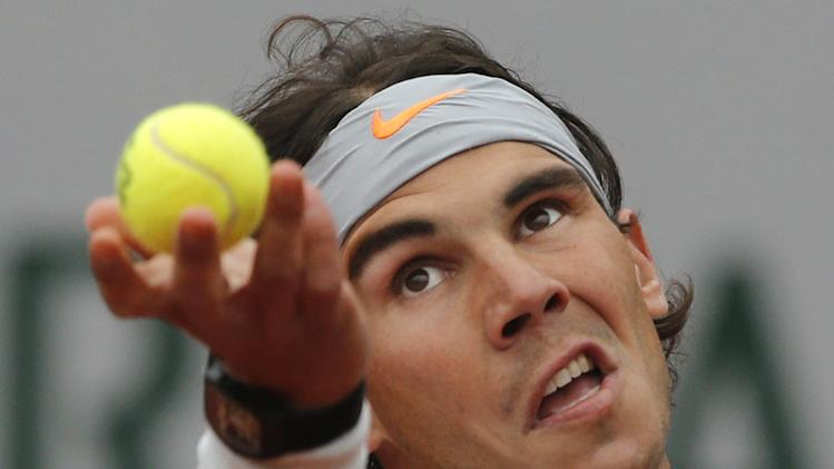 Spain's Rafael Nadal serves against Slovakia's Martin Klizan in their second round match at the French Open tennis tournament, at Roland Garros stadium in Paris, Friday, May 31, 2013. (AP Photo/Michel Spingler)