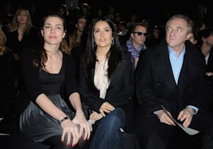 Francois-Henri Pinault, with wife Salma Hayek and Princess Charlotte, lets his eyes wander at a fashion show in Paris. (Photo by Pascal Le Segretain/Getty Images)