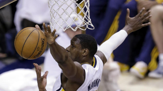 Indiana Pacers center Ian Mahinmi, top, blocks the shot of New York Knicks guard Raymond Felton during the second half of Game 4 of the Eastern Conference semifinal NBA basketball playoff series, in Indianapolis on Tuesday, May 14, 2013. (AP Photo/Michael Conroy)
