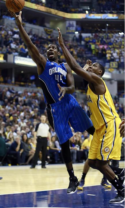 Orlando Magic forward Andrew Nicholson, left, releases a shot next to Indiana Pacers center Roy Hibbert in the first half of an NBA basketball game in Indianapolis, Tuesday, Oct. 29, 2013