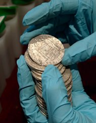 Gold coins from the wreck of a 19th-century Spanish warship the Nuestra Senora de las Mercedes. Descendants of the sunken cargo's owners are fighting to win back part of the booty from Spain. (AFP Photo/)