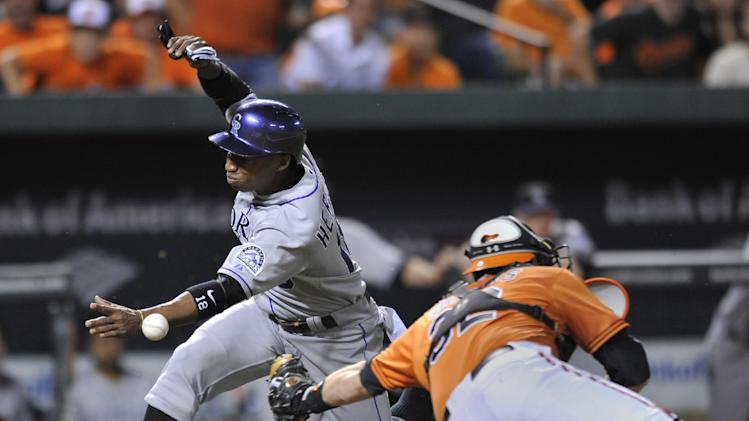 Orioles use 7-run 3rd to beat Rockies 8-4