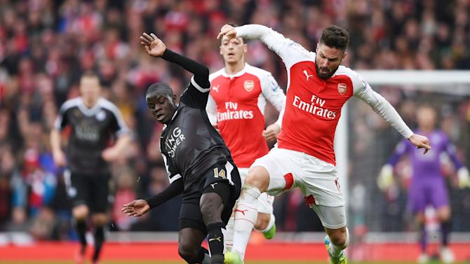 Arsenal's Olivier Giroud in action with Leicester's N'Golo Kante