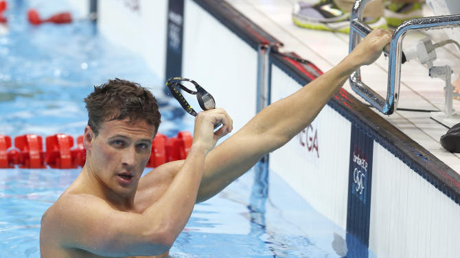 FILE - This July 29, 2012 file photo shows United States' Ryan Lochte  after his relay team's silver medal win in the men's 4x100-meter freestyle relay final men's relay at the Aquatics Centre in the Olympic Park during the 2012 Summer Olympics in London. Lochte is among the Latino U.S. Olympians to be honored at this year's ALMA Awards. Eva Longoria and George Lopez are returning for the third time as co-hosts of this month's awards, which celebrate Latino achievements in music, television and film. The announcement was made Tuesday, Sept. 11. (AP Photo/Daniel Ochoa De Olza, file)