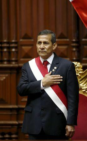 Peruvian President Ollanta Humala sings the national anthem before his speech to the nation at the Congress on Independence Day in Lima