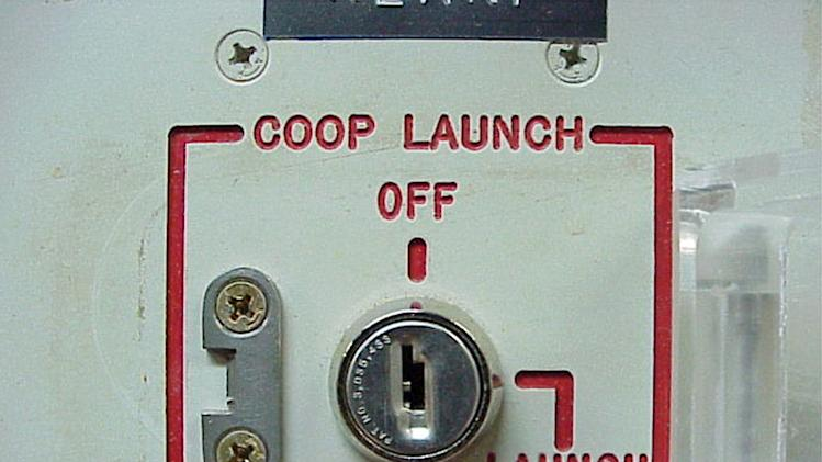 "FILE - This 2002 file photo provided by the National Park Service shows the launch key mechanism at the deactivated Delta Nine Launch Facility near Wall, S.D. The Air Force stripped an unprecedented 17 officers of their authority to control _ and if necessary launch _ nuclear missiles after a string of unpublicized and unacceptable failings, including a potential compromise of missile launch codes. The group's deputy commander said it is suffering ""rot"" within its ranks. The tip-off to trouble was a March 2013 inspection of the 91st Missile Wing at Minot Air Force Base, N.D., which earned the equivalent of a ""D"" grade when tested on its mastery of Minuteman III missile launch operations. (AP Photo/Minuteman Missile NHS)"