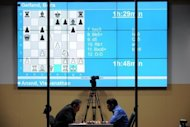 India's Vishwanathan Anand (right) and Israel's Boris Gelfand contest a FIDE World chess championship match in the State Tretyakovsky Gallery in Moscow this week. The grinding epic of the 12-game world chess championship in Moscow is tracked by three remote cameras on the stage and broadcast live to chess fans across the globe