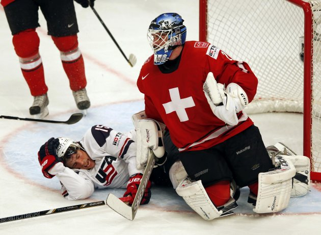Team USA's Smith reacts next Switzerland's Berra during their 2013 IIHF Ice Hockey World Championship semi-final match at the Globe Arena in Stockholm