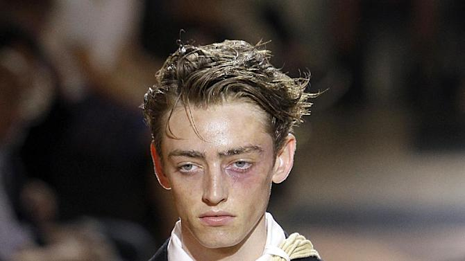 A model wears a creation by Japanese fashion designer Yohji Yamamoto as part of his Men's Spring-Summer 2013 collection, for the Paris Fashion Week, in Paris, France, Thursday, June 28, 2012.  (AP Photo/Francois Mori)