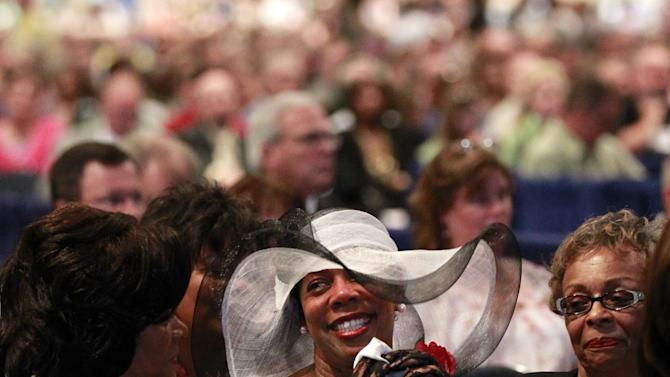 Elizabeth Luter, wife of Fred Luter, Pastor of the Franklin Ave. Baptist Church in New Orleans, reacts as he is elected as president of the Southern Baptist Convention, at the convention in New Orleans, Tuesday, June 19, 2012. Luter is the first African-American to be elected president of the nation's largest Protestant denomination. (AP Photo/Gerald Herbert)