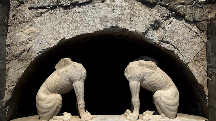 In this handout photo released by the Greek Culture Ministry on Thursday, Aug. 21, 2014, two large stone sphinxes are seen under a barrel-vault topping the entrance to an ancient tomb under excavation at Amphipolis in northern Greece. Archaeologists excavating the large grave mound on Thursday asked politicians and others seeking guided tours of the site to leave them in peace until the dig is completed. The partially uncovered tomb, from the end of Greek warrior-king Alexander the Great's reign, has captivated the public imagination, fueling wild speculation that it may contain rich treasure and the bones of an ancient celebrity. (AP Photo/Culture Ministry, HO)
