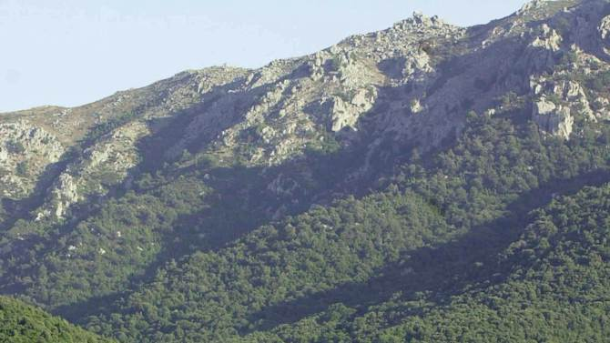 FILE- This Aug. 29, 2000, file photo, shows an unnamed village nestled in the bush and the mountain in southern Corsica, France. Organized crime is gaining ground, spreading beyond the usual vices on the mainland to real estate, tourism and politics back home.  (AP Photo/Bob Edme, File)
