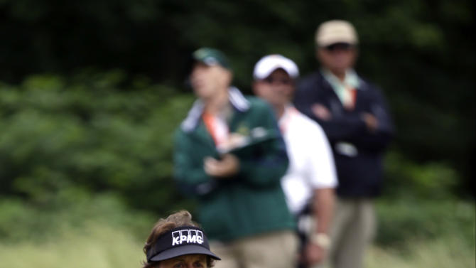 Phil Mickelson reacts to a missed birdie putt on the 17th hole during the first round of the U.S. Open golf tournament at Merion Golf Club, Thursday, June 13, 2013, in Ardmore, Pa. (AP Photo/Morry Gash)