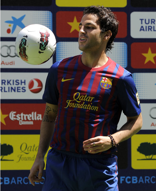 Barcelona's new player Cesc Fabregas plays with a ball during his official presentation at the Camp Nou's stadium in Barcelona, after signing a new contract with the Catalan club, on August 15, 2011. Arsenal captain Cesc Fabregas has completed his move to Barcelona by signing a five-year contract with his boyhood club. AFP PHOTO/LLUIS GENE (Photo credit should read LLUIS GENE/AFP/Getty Images)