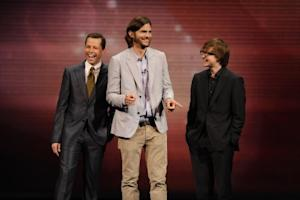 Jon Cryer, Ashton Kutcher and Angus T. Jones share a laugh at the CBS Upfront at Carnegie Hall in New York City on May 18, 2011  -- CBS