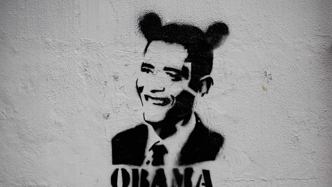 """This July 21, 2015 photo shows an image of President Barack Obama wearing fake ears and the slogan """"Obama go home"""" on a street wall in Caracas, Venezuela. Venezuelan President Nicolas Maduro regularly sets social media afire with support, with heavily trending anti-U.S. campaigns such #ObamaYankeeGoHome and #ObamaRepealTheExecutiveOrder, which denounced U.S. sanctions on members of Maduro's administration. (AP Photo/Ariana Cubillos)"""