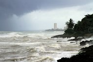 View of choppy seas in front of Santo Domingo's Malecon seafront in the Dominican Republic. Hundreds of thousands of Haitians living in squalid makeshift camps hunkered down Wednesday as lashing rain and wind from the outer bands of Tropical Storm Emily hit the quake-stricken country