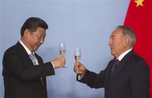 Kazakhstan's President Nazarbayev and his Chinese counterpart Xi toast after signing bilateral documents in Astana