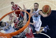 Argentina&#39;s Manu Ginobili, right, drives to the basket against Russia&#39;s Andrei Kirilenko, center, during the men&#39;s bronze medal basketball game at the 2012 Summer Olympics, Sunday, Aug. 12, 2012, in London. (AP Photo/Eric Gay, pool)