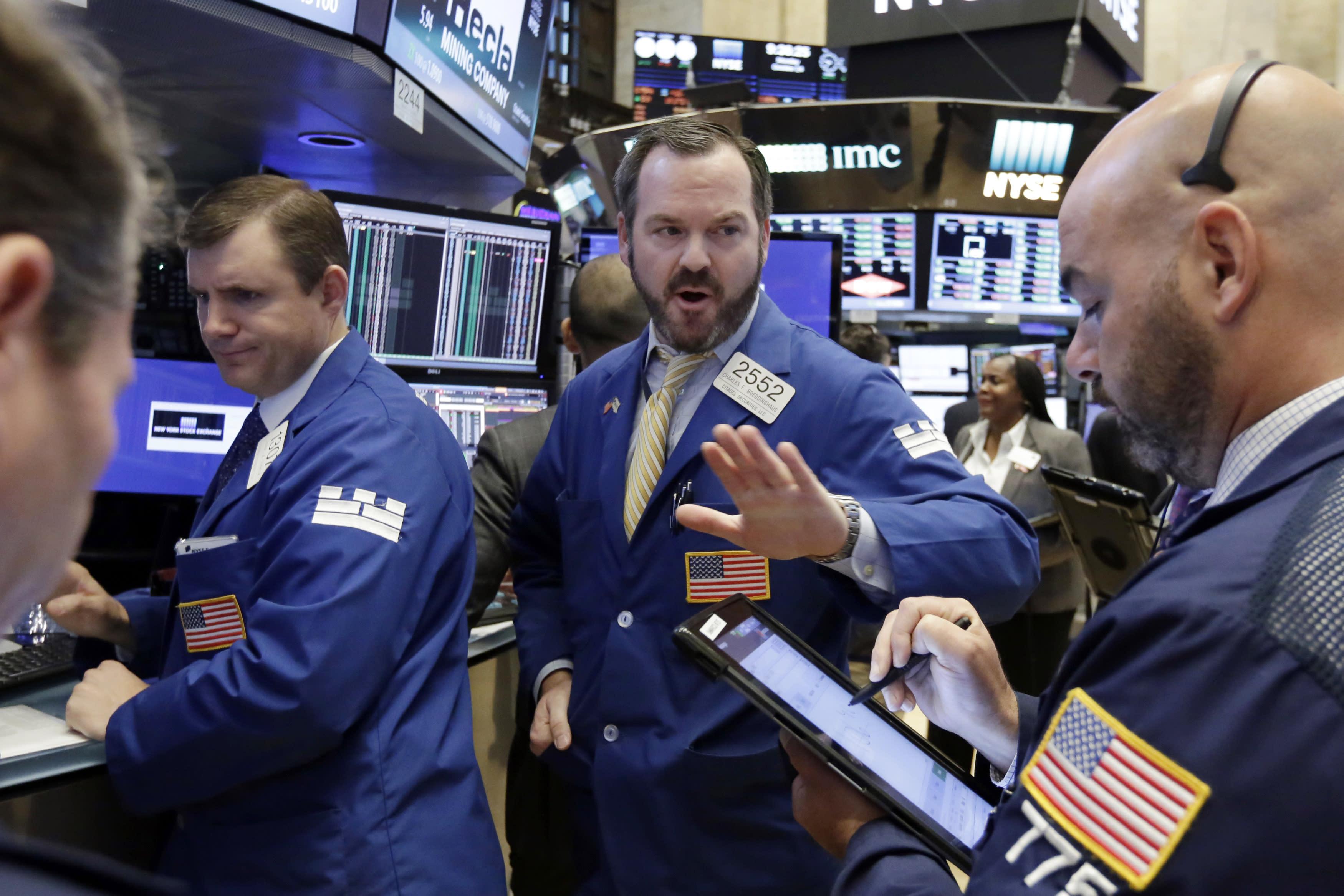 Wave of deals lead US stocks higher; tech companies jump