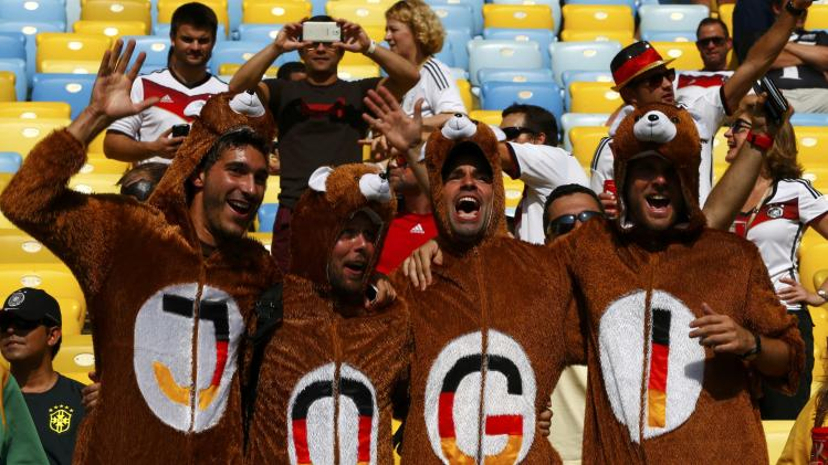 Germany fans dressed in bear costumes cheer before the team's 2014 World Cup quarter-finals against France in Rio de Janeiro