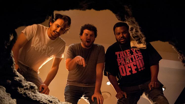 "This film publicity image released by Columbia Pictures shows, from left, James Franco, Danny McBride and Craig Robinson in a scene from ""This Is The End."" (AP Photo/Columbia Pictures - Sony, Suzanne Hanover)"