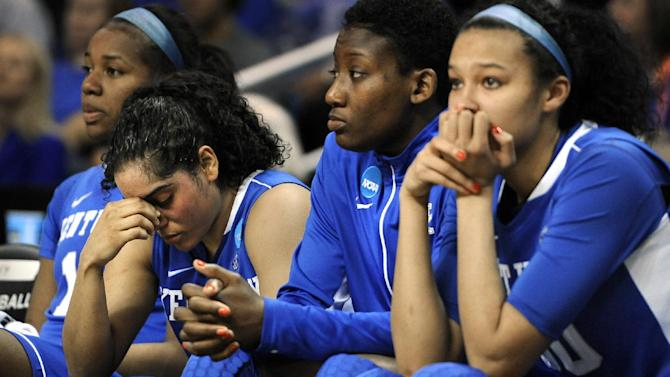 Kentucky's DeNesha Stallworth, from left, Jennifer O'Neill, Brittany Henderson and Azia Bishop react during the final minutes of their regional final game against Connecticut in the women's NCAA college basketball tournament in Bridgeport, Conn., Monday, April 1, 2013. Connecticut won 83-53. (AP Photo/Jessica Hill)