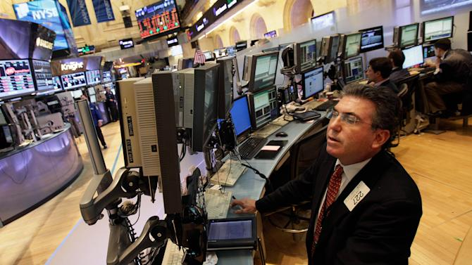 In a May 7,2012 photo trader John Bishop works on the floor of the New York Stock Exchange.  Wall Street looks set for a higher opening on Friday May 18, 2012, when shares of social media giant Facebook will start trading.  (AP Photo/Richard Drew)