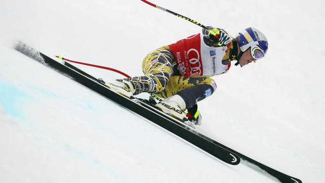 "FILE = In this Feb. 18, 2012 file picture Lindsey Vonn, of the United States, competes during a women's World Cup downhill on the Sochi Olympics course, in Krasnaya Polyana, near Sochi, Russia . The United States ski team says it hasn't had any ""formal discussion"" yet about the possibility of Lindsey Vonn entering a men's World Cup downhill next month.  Vonn, the women's Olympic downhill champion, has written the International Ski Federation to ask whether she can challenge the men on Nov. 24 in Lake Louise, Alberta. Vonn has earned nine of her 26 World Cup downhill victories at the Canadian track, which stages women's races the following weekend. The U.S. Ski and Snowboard Association says ""we clearly have great respect for Lindsey, her accomplishments in the sport and her desire to seek this new challenge. But we have not had any formal discussion yet between Lindsey and FIS.""  FIS secretary general Sarah Lewis tells The Associated Press the governing body can't make a decision on the matter until the team submits a formal request.   (AP Photo/Alessandro Trovati,File)"