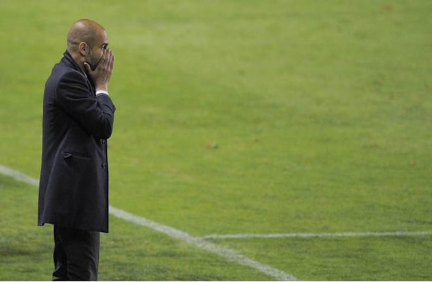 FC Barcelona's Coach Josep Guardiola Reacts AFP/Getty Images