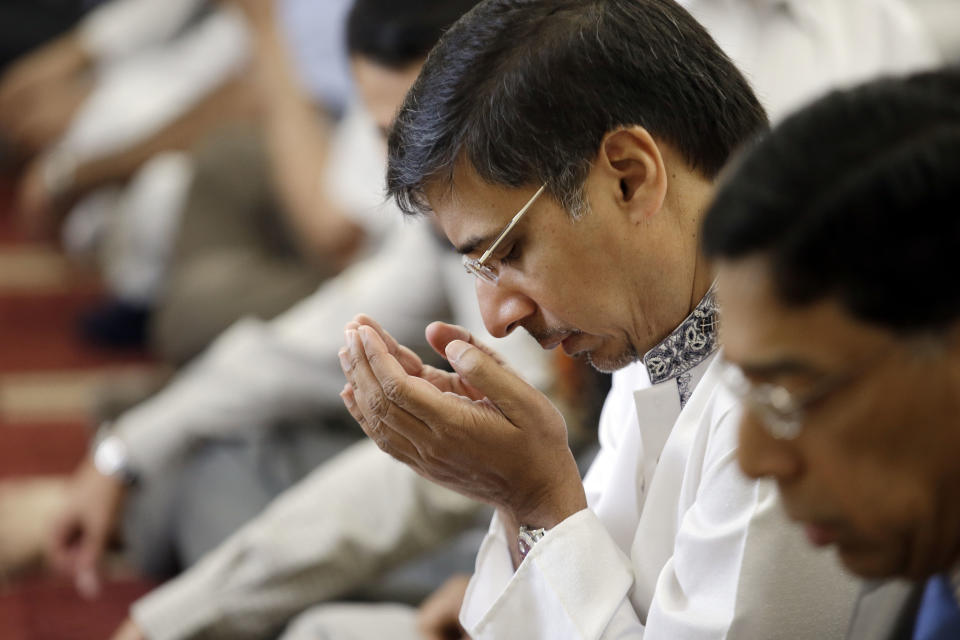 Nadeem Qureshi attends midday prayers at the Islamic Center of Murfreesboro on Friday, Aug. 10, 2012, in Murfreesboro, Tenn. Opponents of  the mosque waged a two-year court battle trying to keep it from opening. (AP Photo/Mark Humphrey)