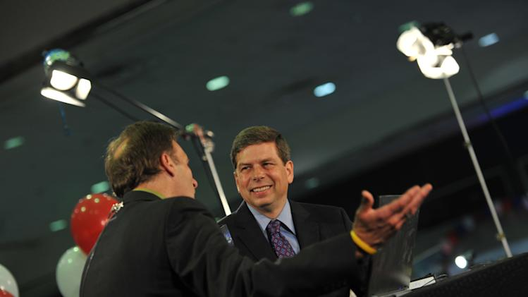 Incumbent U.S. Sen. Mark Begich, D-Alaska, is interviewed on television in downtown Anchorage, Alaska on Tuesday, Aug. 19, 2014. Begich won Tuesday's primary for Democratic candidate for the U.S. Senate in November. (AP Photo/Michael Dinneen)