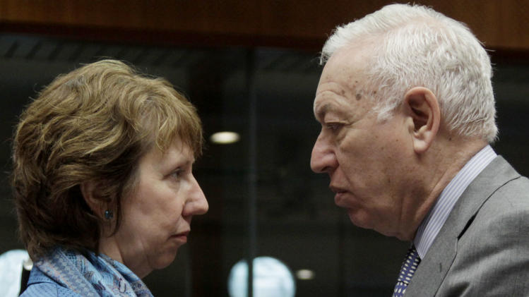 EU foreign policy chief Catherine Ashton, left, speaks with Spain's Foreign Minister Jose Manuel Garcia-Margallo during a meeting of EU foreign ministers at the EU Council building in Brussels on Monday, Feb. 27, 2012. EU foreign ministers are trying to increase the pressure on Syria's regime to stop its violent crackdown on opponents. Diplomats say the 27 EU foreign ministers, meeting Monday in Brussels, will freeze the assets of seven Syrian government officials, impose sanctions on the country's central bank and ban Syrian cargo flights from the European Union. (AP Photo/Virginia Mayo)