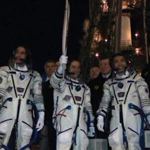 Olympic torch reaches ISS