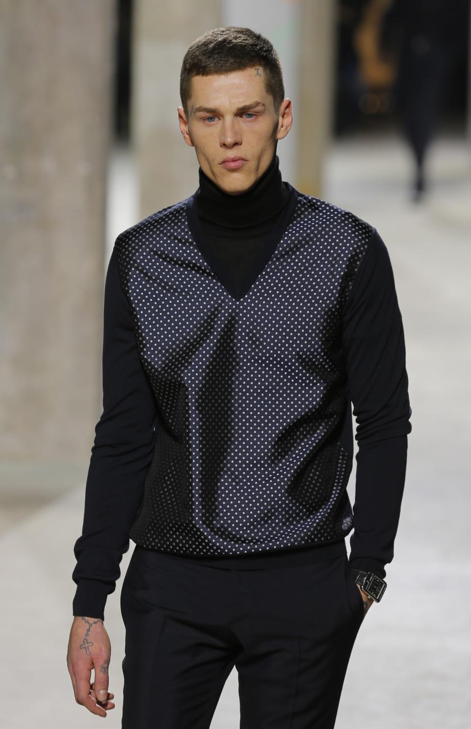 A model wears a creation by French fashion designer Veronique Nichanian as part of the Men's fall-winter 2013-2014 fashion collection presented in Paris, Saturday Jan. 19, 2013. (AP Photo/Jacques Brinon)