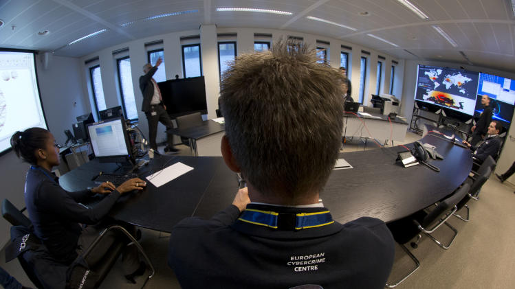 Employees of Europol's Cybercrime Center are seen during a media tour at the occasion of the official opening of the Cybercrime Center at Europol headquarters in The Hague, Netherlands, Friday Jan. 11, 2013. (AP Photo/Peter Dejong)