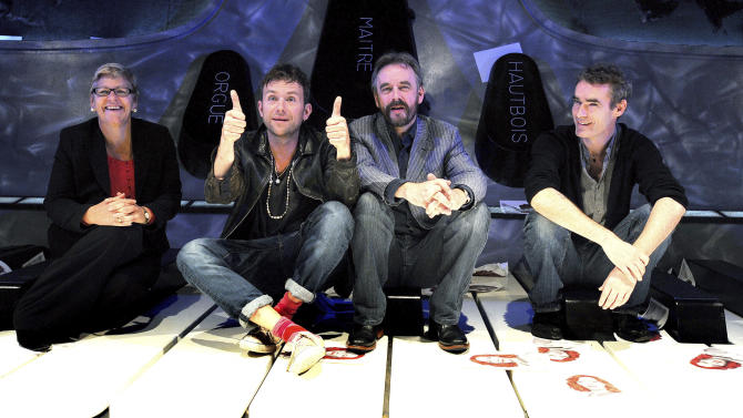 "From left to right, Chief Executive of the ENO Loretta Tomasi, musician Damon Albarn, artistic directors of the ENO John Berry and Rufus Norris during a press conference for Undress for the Opera, at the Coliseum Theatre, in London, Wednesday, Oct. 3, 2012. A Python and the founder of Gorillaz are trying to help opera shed its stuffy image. Monty Python's Terry Gilliam and Blur and Gorillaz singer Damon Albarn are supporting English National Opera's plan to entice new audience members with the promise of casual clothes, cheap tickets and cocktails. The company hopes to attract more newcomers with its ""Undress for the Opera"" initiative, which reassures operagoers that it's OK to show up in jeans. Albarn hopes perceptions of opera as stuffy and expensive will change. He said Wednesday that ""we're carrying into this century a lot of ideas that belong to a previous generation."" (AP Photo/John Stillwell, PA) UNITED KINGDOM OUT"