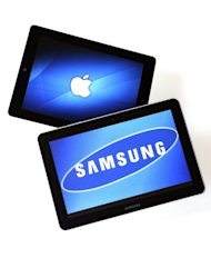 This file photo shows a Samsung Galaxy Tab 10.1 tablet (R) and an iPad 2. A judge on Monday lifted a ban on US sales of Samsung Galaxy Tab 10.1 computers as legal brawling continued between the South Korean electronics titan and Apple