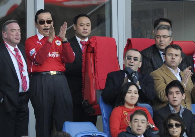 Cardiff City's owner Vincent Tan is seen with Club Chairman Mehmet Dalman during their English Premier League soccer match against Fulham at Cardiff City Stadium in Cardiff